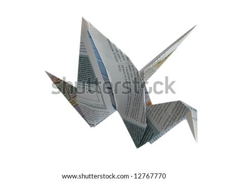 Close up origami newspaper crane isolated on white background - stock photo
