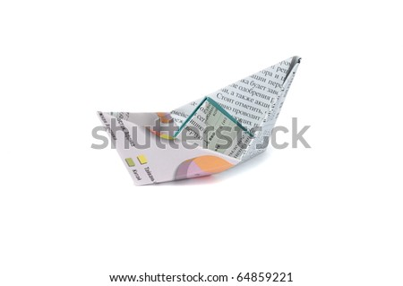 Close up origami newspaper ship isolated on white background - stock photo