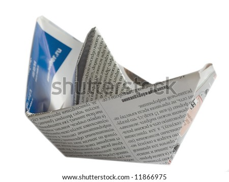 Close up origami newspaper ship isolated on white background  (newspaper origami series)