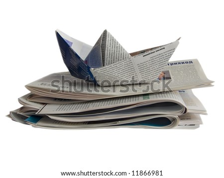 Close up origami newspaper ship isolated on white background  (newspaper origami series) - stock photo