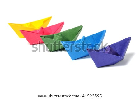 Close up origami ship over white