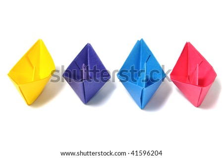 Close up origami ship over white - stock photo