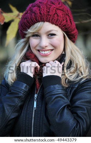 Close Up Outdoor Portrait Of Young Blonde Woman - stock photo