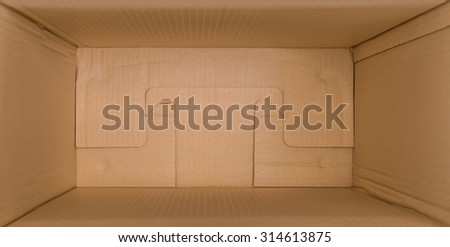 close up packed or hidden inside a cardboard packaging box - stock photo