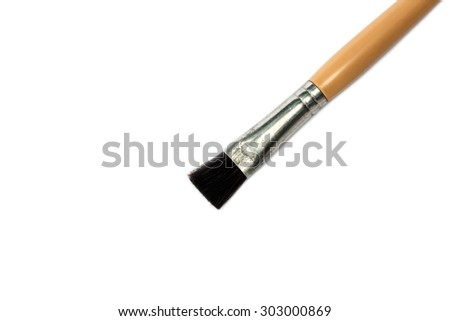 close-up paintbrush isolated on white.