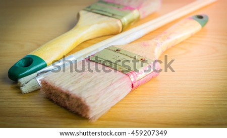 close up Paintbrush on wood floor texture background