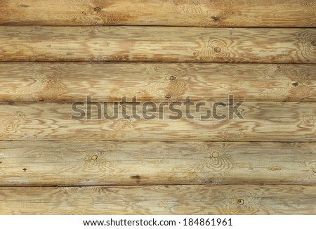 close-up part of the wall of a new wooden hut in daylight