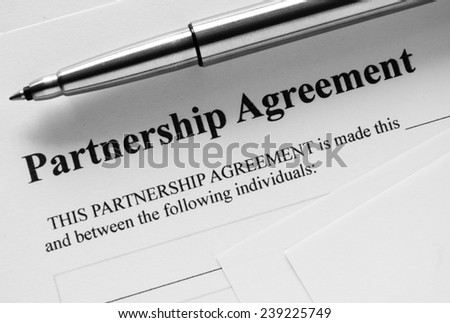 Close up Partnership Agreement Paper and Pen, Emphasizing the Title Part.