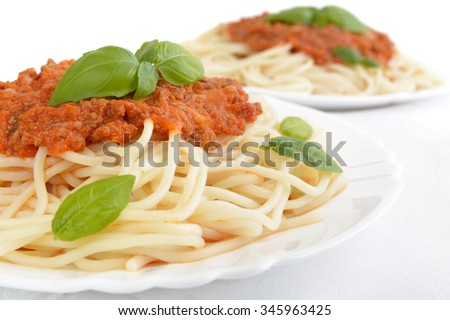 Close up pasta with ragu alla bolognese sauce on white - stock photo