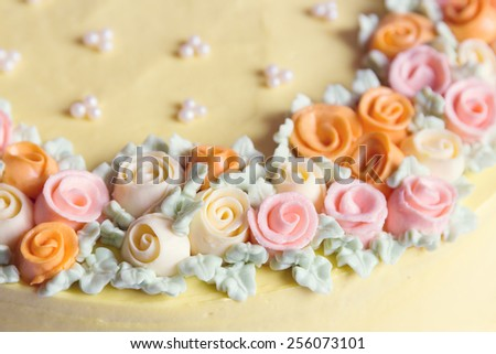 Close up pastel colored cream flowers cake decoration. Shallow focus - stock photo