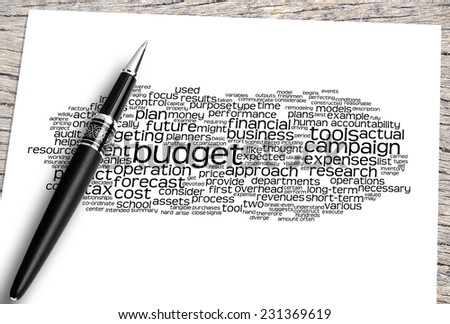 Close Up Pen And Paper On The Wooden Table With Budget Word Cloud And Its Related. - stock photo