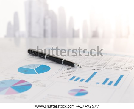 Close-up pen on financial report. Concept of Financial, Data Analysis, Investment Planning, Business Analytics. - stock photo