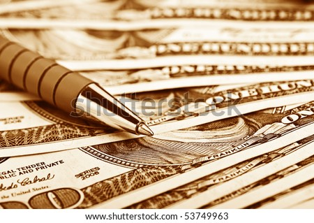 close-up pen on the money with shallow DOF - stock photo