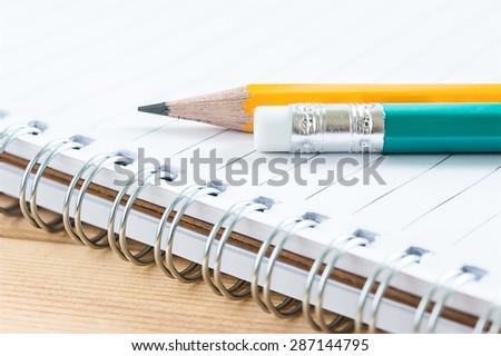 close-up pencil on notebook - stock photo