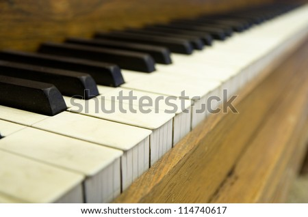 close up perspective image of old piano keys with shallow depth of field