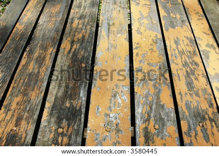 Close up perspective view of weathered wood planks - stock photo