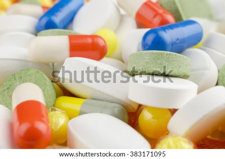 Close-up. Pharmacy theme. Heap of medicine multi colored pills