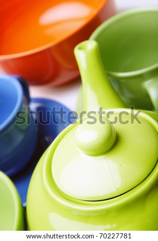 Close-up phot of the teapot and teacups. Natural saturated colors. Shallow depth of field added by macro lens for natural view - stock photo