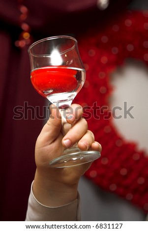 Close up photo hand and wine glass