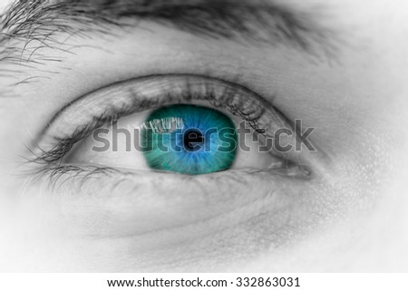 Close up photo of a beautiful young man's eyes - stock photo