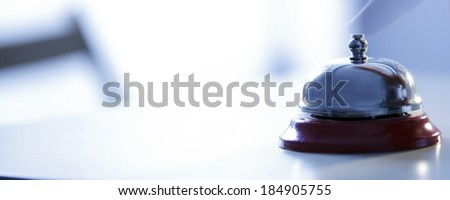 Close up photo of a bell in a hotel - stock photo