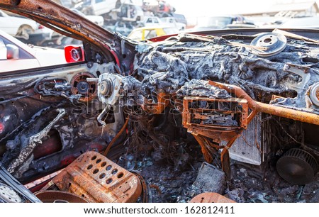 Close up photo of a burned out car