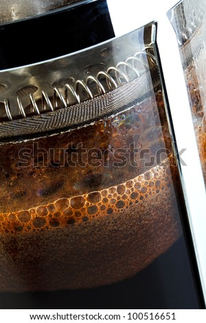 Close up photo of a Cafetiere with freshly brewed coffee inside, this is also know as a French press, Coffee plunger, Coffee press or Caffettiera. - stock photo