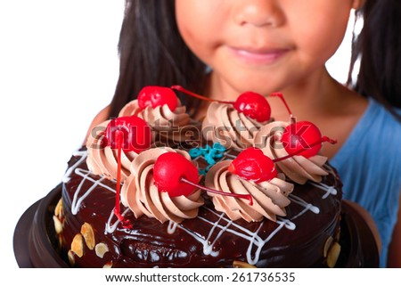 Close-up photo of a cake child's hands, focus on a cake. - stock photo