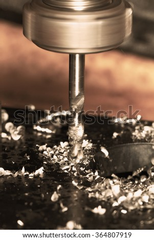 Close up photo of a CNC drilling