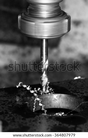 Close up photo of a CNC drilling  - stock photo