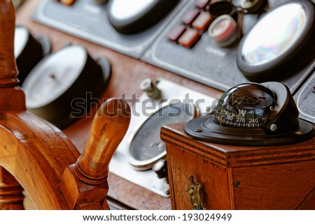 Close up photo of a compass in the ship - stock photo