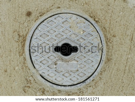Close up photo of a gray outdoor faucet cover - stock photo