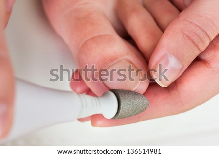 Close-up Photo Of A Hand Manicuring Nails - stock photo