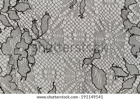 Close up photo of a lacy tablecloth - stock photo