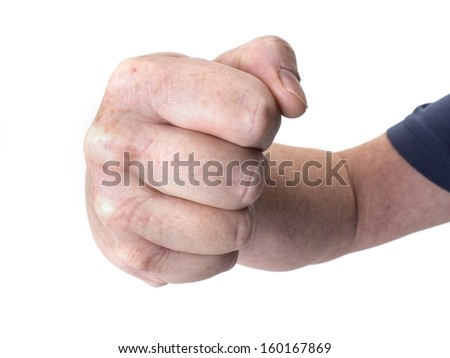 Close up photo of a large threatening fist isolated on white - stock photo