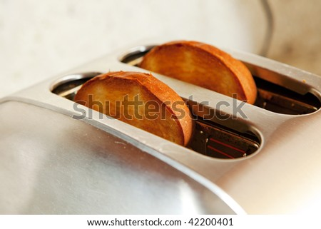 close up photo of a sliced bread in a toaster - stock photo