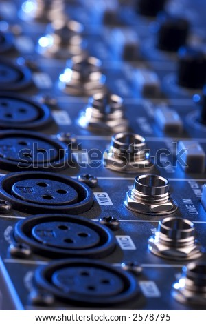 Close-up photo of a sound mixing board