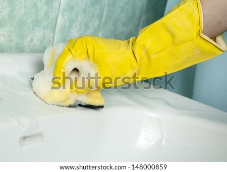 Close up photo of a woman cleaning the sink - stock photo