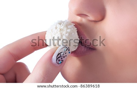 Close up photo of a women with coconut praline - stock photo