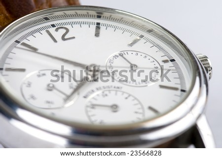 Close-up photo of a wrist watch with focus on 12 sign