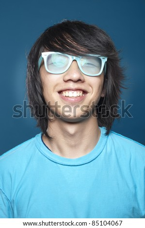 Close up photo of a young asian man smiling, very happy.