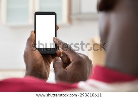 Close-up Photo Of  African Man Holding Cellphone - stock photo