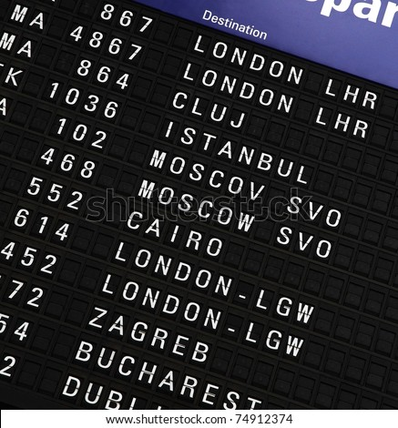 Close-up photo of airport departure board - stock photo