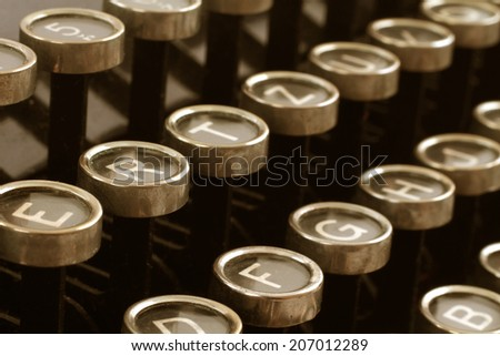 Close up photo of antique typewriter keys, shallow focus  - stock photo