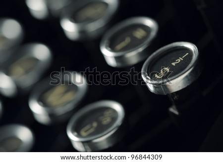 Close up photo of antique typewriter keys, shallow focus - stock photo