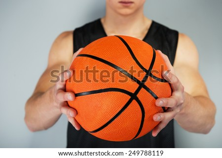 Close up photo of ball in a young male basketball player hands - stock photo