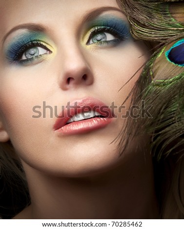 close up photo of beautiful woman's face with fashion makeup - stock photo