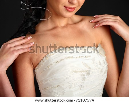 close up photo of bride wearing wedding dress, half