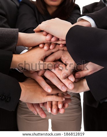 Close-up photo of business people hands stack - stock photo