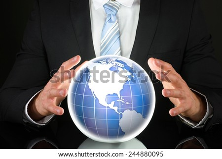 Close-up Photo Of Businessman Hand On Globe